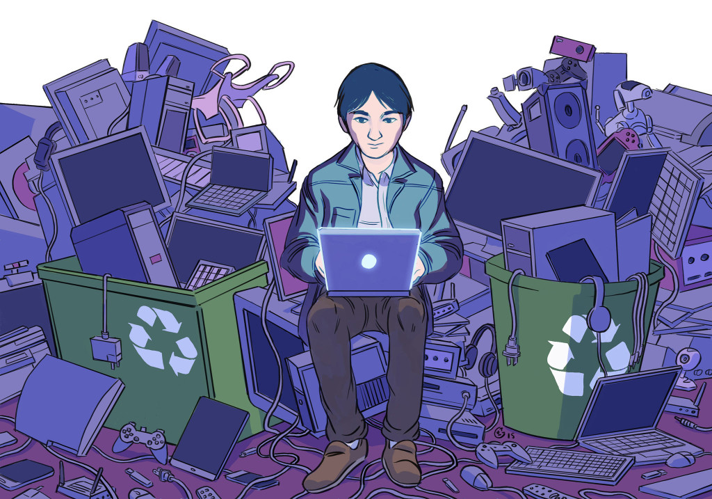 Man on Laptop Surrounded by E-Waste
